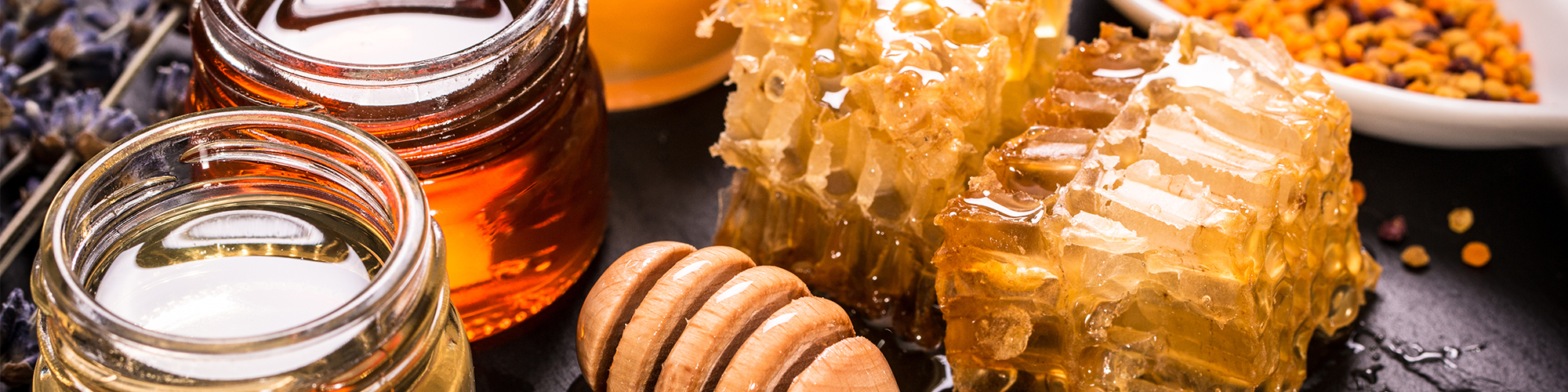 Honeycomb and Jars of Honey